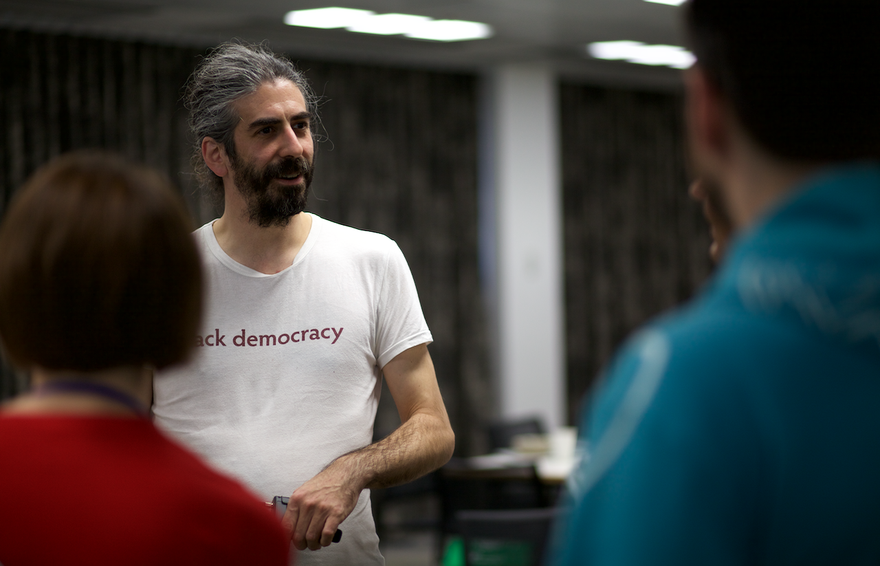 Matthew Landauer talking with attendees after his presentation